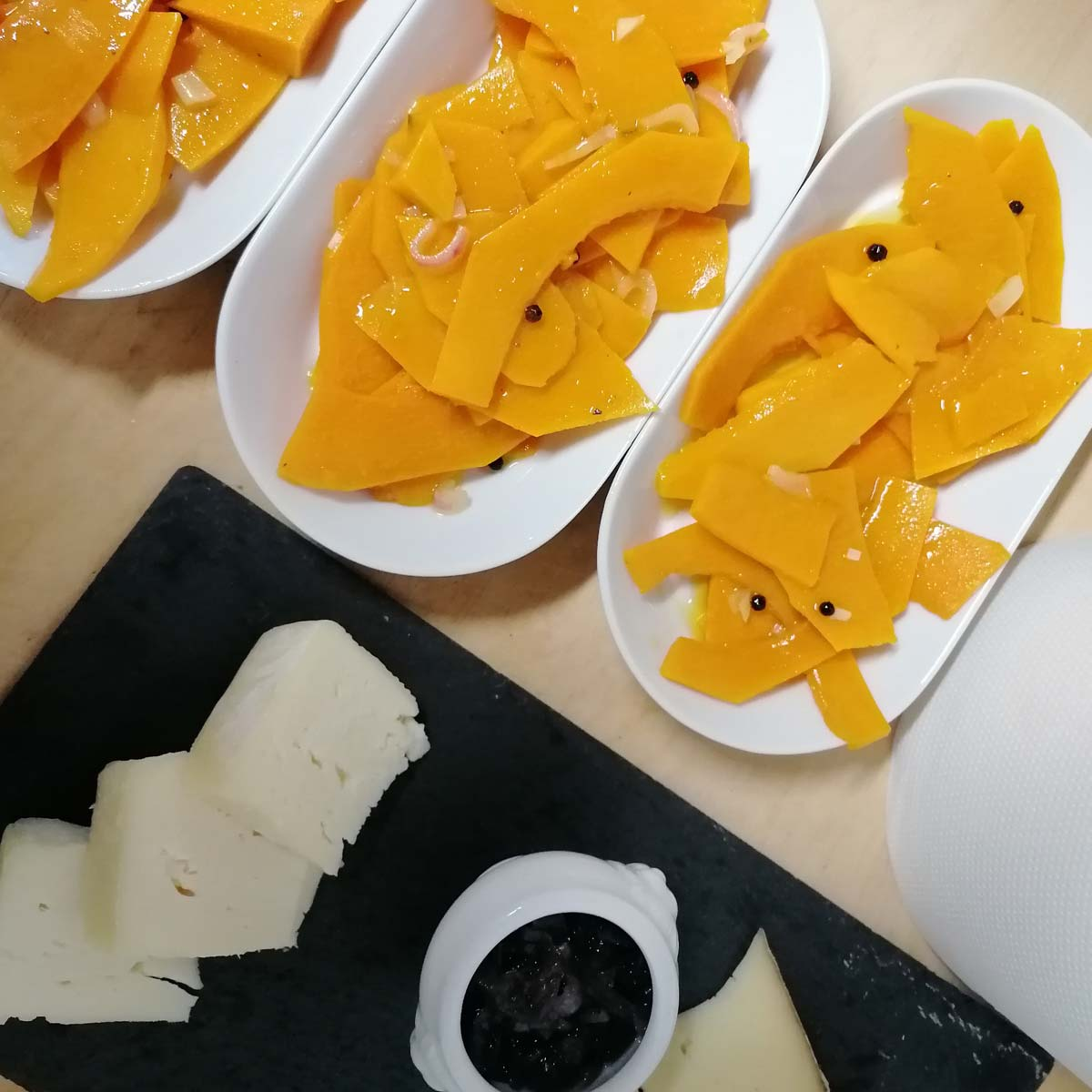 Platter of cheese with marinated pumpkin